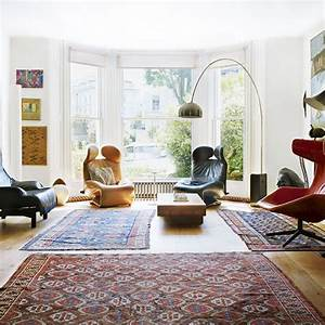 Living room with multiple patterned rugs how rugs can for Several living room ideas can count