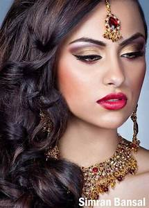indian bride make up, purple and gold make up with red ...