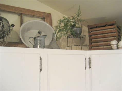 decorating   kitchen cabinets  antiques vintage knick knacks shelf styling