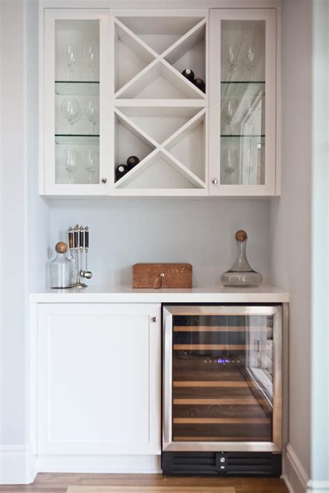 Any efficient home coffee bar has, at minimum, some sort of coffeemaker, a mug to hold it, and coffee storage; Chic White Dry Bar Offers Built-In Wine Storage | HGTV