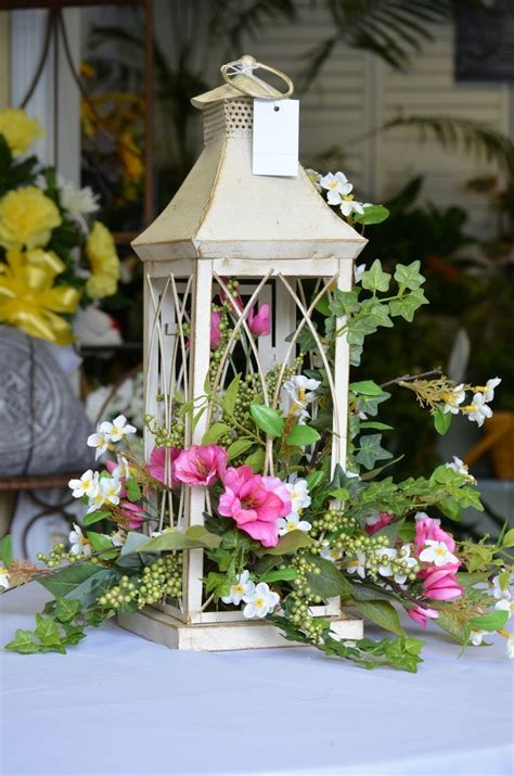 A delightful silk arrangement in a lantern Never thought