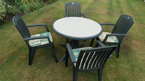Garden Round Table And 4 Chairs, Green Plastic, Used. By Hartman. Includes 4 Cushions