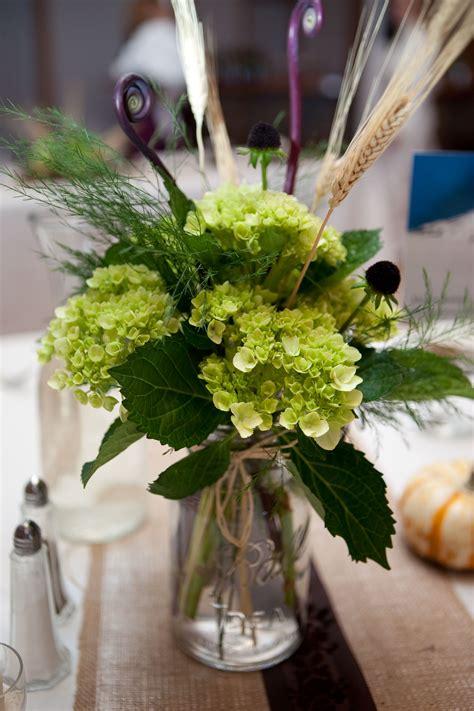 Ferns Hydrangea Centerpieces White Pillar Candles Moss