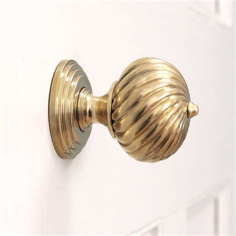 brass door knobs burcot swirl brass door knobs pair