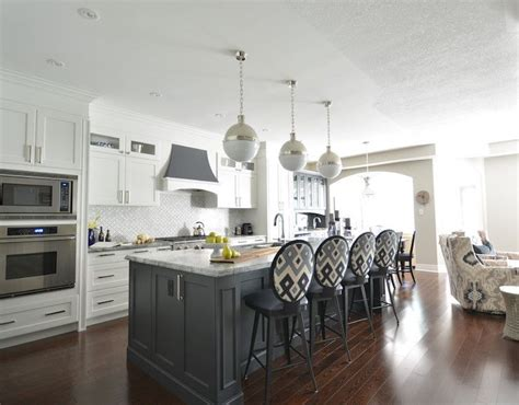 white kitchen  gray island transitional kitchen