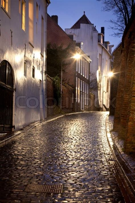wet street   houses  night  stock photo