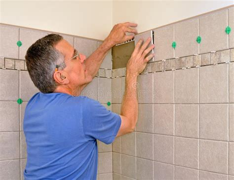 Man Installing Ceramic Tile In Bathroom Stock Photo. Concrete Flooring Kitchen. Yellow Backsplash Kitchen. Type Of Flooring For Kitchen. Tile Backsplash For Kitchens With Granite Countertops. Photos Of Kitchen Backsplash Ideas. Kitchen Sink Backsplash Ideas. Kitchen Tile Floor Design Ideas. Bright Kitchen Colors Schemes
