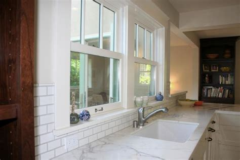 white transitional kitchen  marble counters