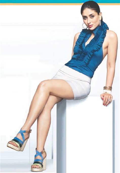 sitting crossed leg    table bollywood actress