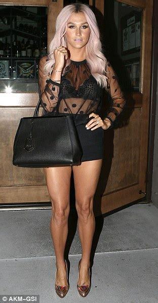 kesha wears   black top  hot pants  jimmy