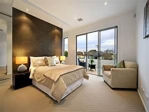 Modern bedroom design idea with carpet & bi-fold windows