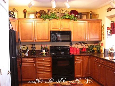 top of kitchen cabinet ideas ideas for tops of cabinets space above cabinet decorating