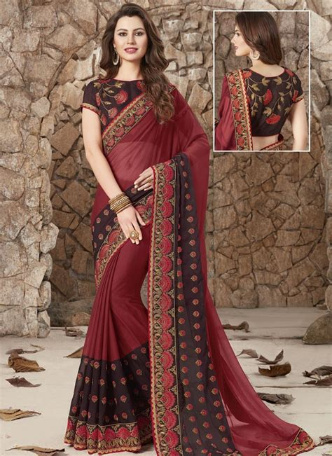 Deep round neck with puffed sleeve premium fabric with attractive embroidered border and grand contrast work blouse. Buy Chiffon Satin Embroidered Work Coffee Brown and Crimson Trendy Designer Saree Online