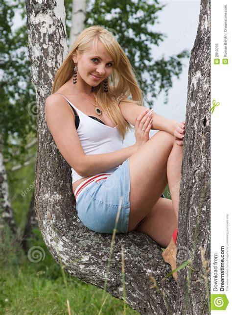 Pretty Girl Sit On Birch Royalty Free Stock Photos