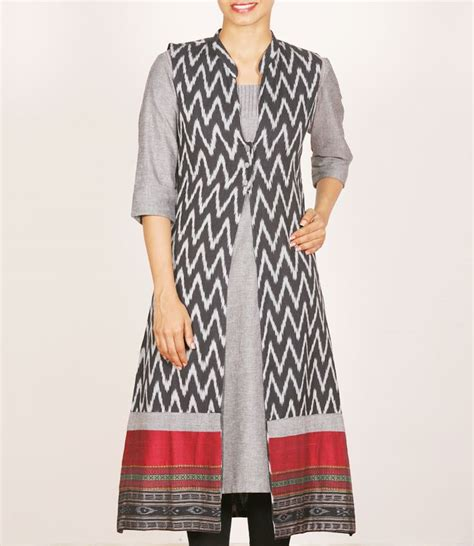 grey cotton dress paired with shiny black black with white ikat overcoat paired with grey kurti