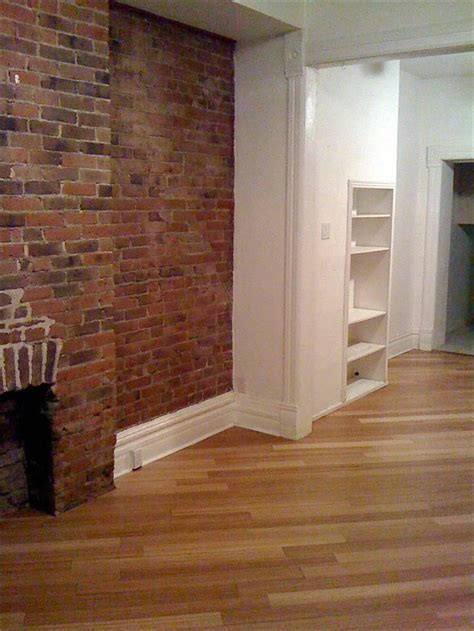 living room exposed brick bamboo hardwood floors photo