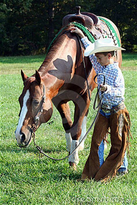young cowboy  horse royalty  stock image image