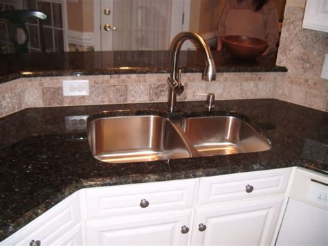 granite undermount kitchen sinks similar layout with backsplash the sink and a 3905