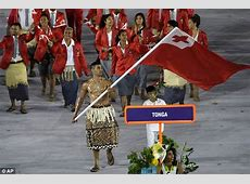 Tonga flag bearer Pita Taufatofua enters Olympic stadium