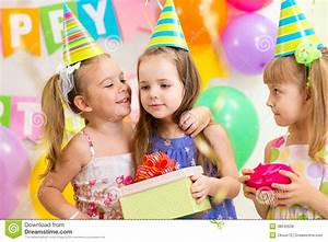 Pretty Children Giving Gifts On Birthday Party Stock Photo ...