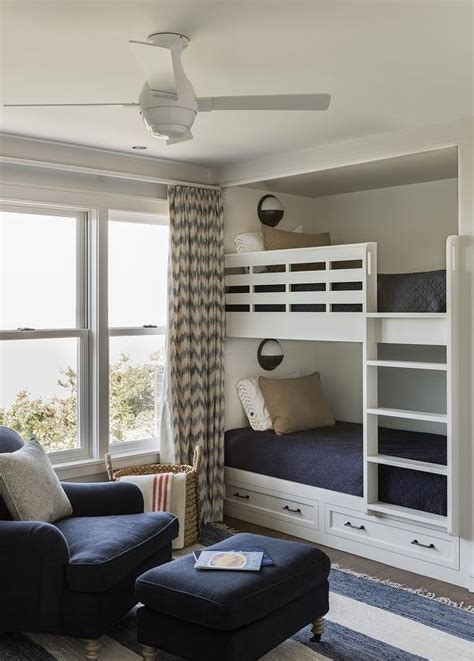 Every item on this page was curated by an elle decor editor. Built In Bunk Beds with Nautical Wall Sconces - Transitional - Boy's Room