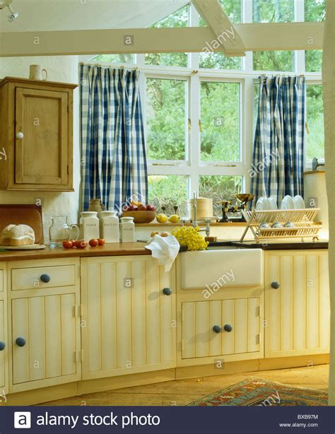 curtains for kitchen window above sink blue white checked curtains on window above sink in