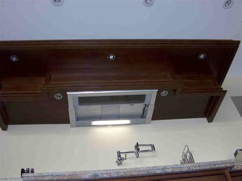 kitchen exhaust fan under cabinet dark maple kitchen