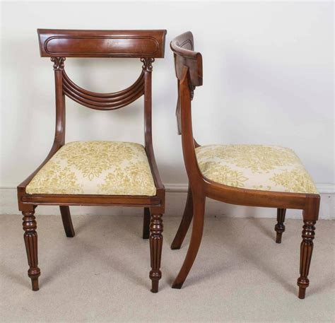 set of 16 vintage regency style dining chairs swag back