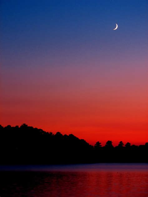 sunset  crescent moon    storm move