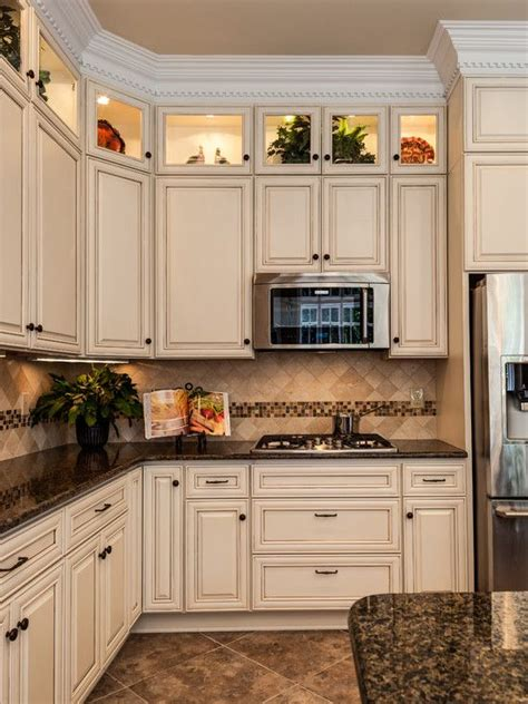i this color scheme tropical brown granite with creme cabinets and tumbled travertine