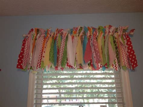 Curtain fun! Strips of fabric tied to a curtain rod with