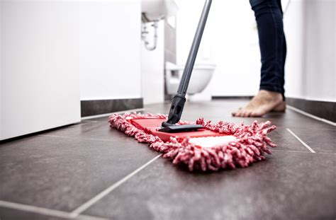 cleaning  adhesive floor tiles