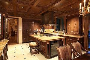 Lush carved wood cabinetry details abound in this kitchen