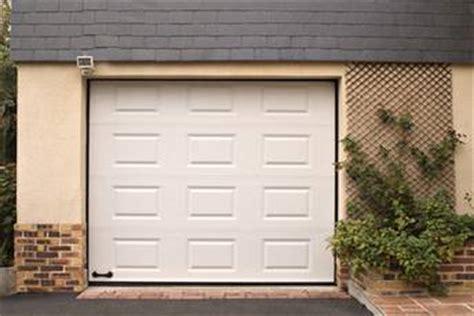 comment poser une porte de garage sectionnelle