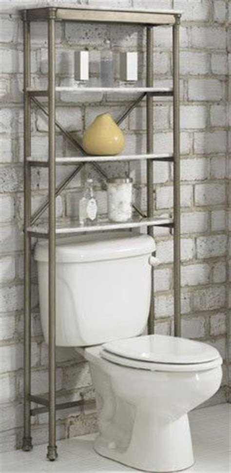 small bathrooms    toilet shelving system