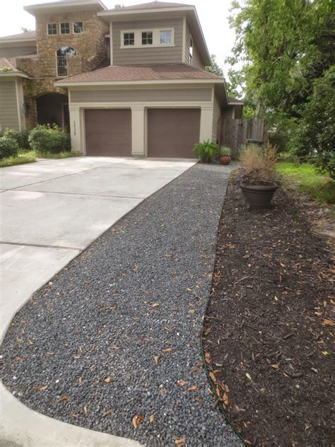 Gravel Yard by Tropical Texana Preventing Yard Wars Boundary Ideas When