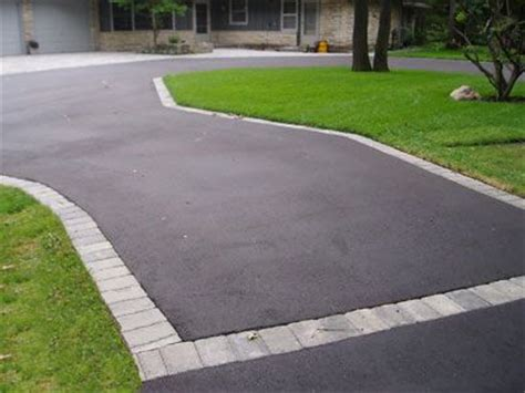 driveway edging materials spruce up an asphalt driveway with a paver edge creative landscaping pinterest blacktop