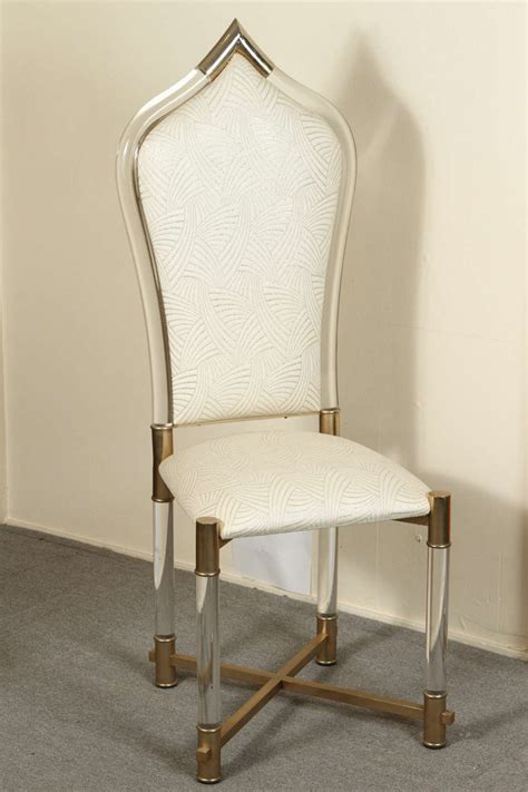 set of eight lucite dining chairs with lucite and brass