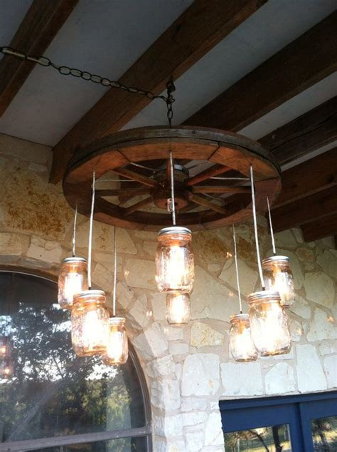 wagon wheel light with mason jars 18 diy mason jar chandelier ideas guide patterns