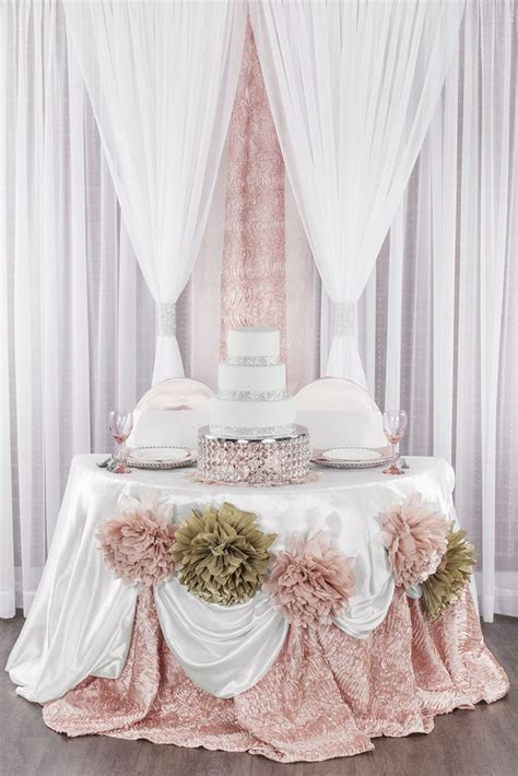 Blush and champagne sweetheart table with crystal cake