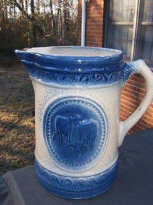 milk pitcher 1259 blue cow pattern stoneware and cow on