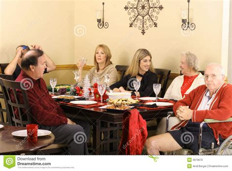 talking   dinner table stock photo image