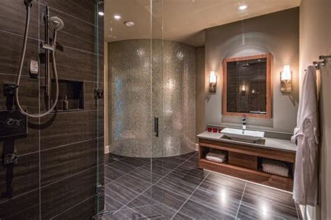 glass door shower  floating vanity  curved accent