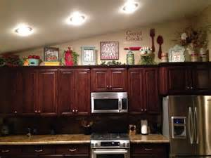 how to decorate on top of cabinets with vaulted ceiling