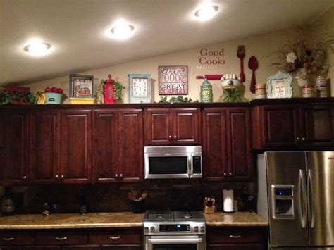 top of cabinet decor how to decorate on top of cabinets with vaulted ceiling