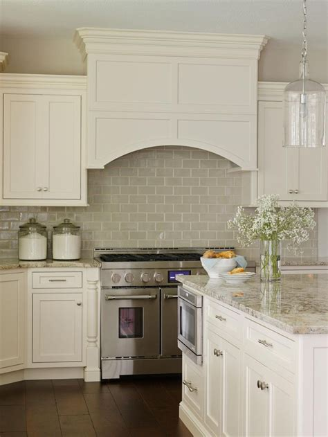 kitchen backsplash tile with white cabinets off white cabinetry paired with a glossy neutral tile