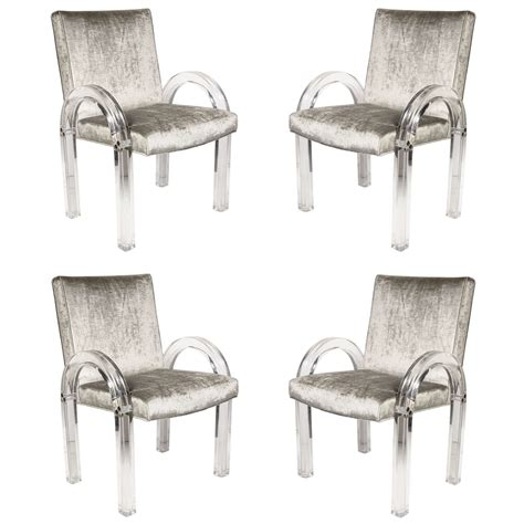 set of four u shaped lucite dining chairs by charles