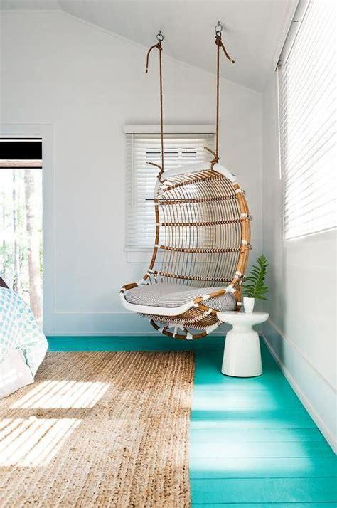 beach style girls bedroom boasts  corner rattan chair