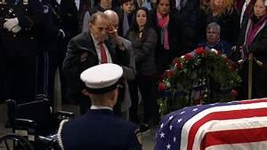 Bob Dole salutes Bush's casket - CNN Video