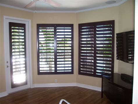 Wood Plantation Shutters by Wood Plantation Shutters With Yellow Brown Walls And